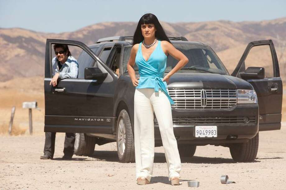 """Universal Pictures photo: Salma Hayek, here with Benicio del Toro, does a little scene stealing in Oliver Stone's darkly funny drug romp, """"Savages."""" Photo: AP / Copyright: © 2012 Universal Studios. ALL RIGHTS RESERVED. Copyright: © 2012 Universal Studios. ALL RIGHTS RESERVED."""