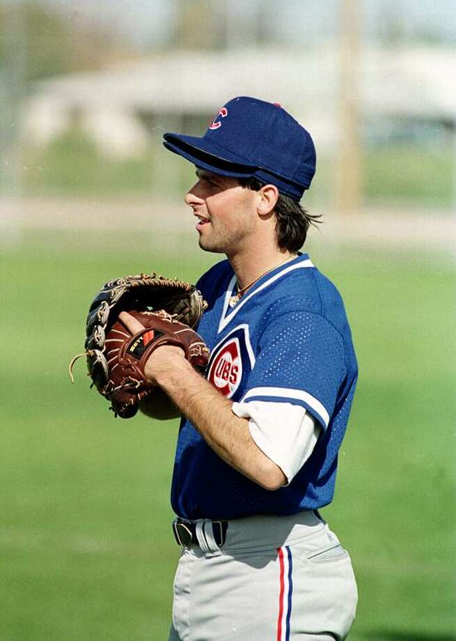 Chicago Cubs pitcher Turk Wendell wears two gloves and caps during a spring training workout at the club's facility in Mesa, Ariz., March 25, 1992.  (AP Photo) Photo: ASSOCIATED PRESS / AP1992