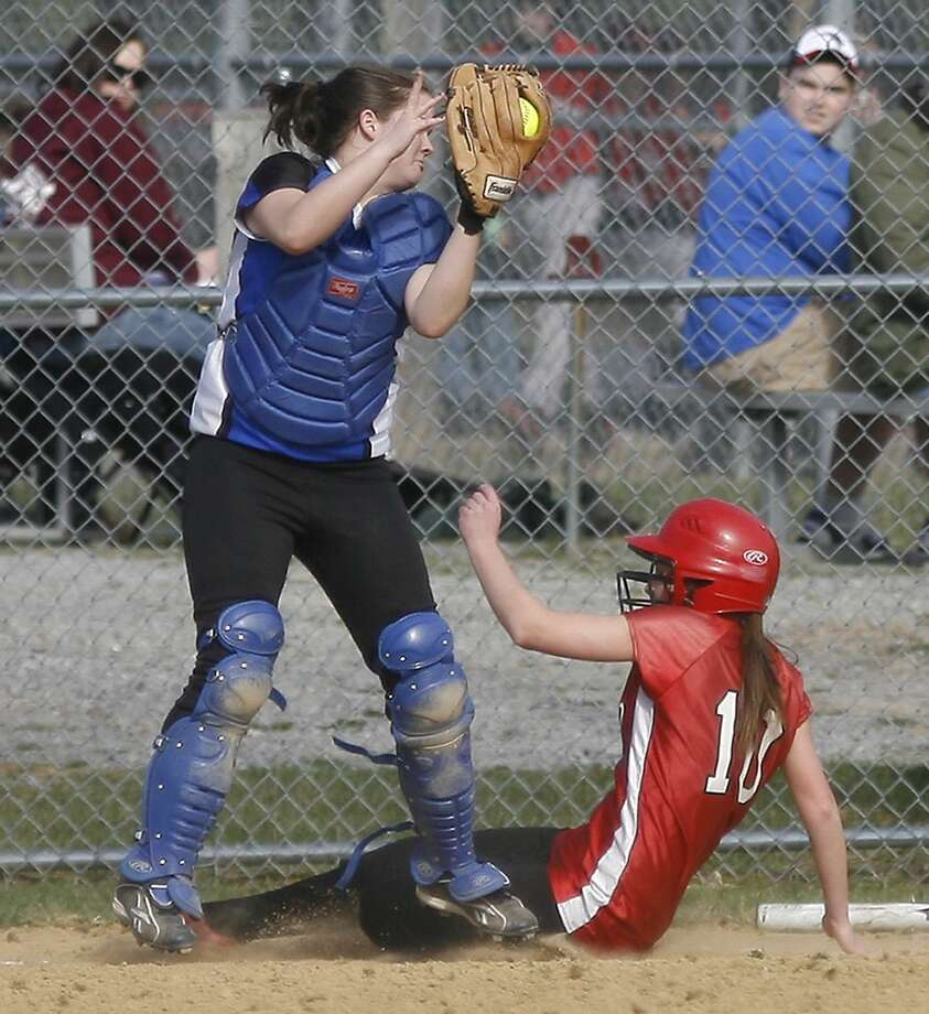 Dispatch Staff Photo by JOHN HAEGER VVS' Jenna Dunne (10) slides into home as Camden's Tori Schultz (9) reaches for the throw in the bottom of the first inning at VVS on Tuesday, April 12, 2011.