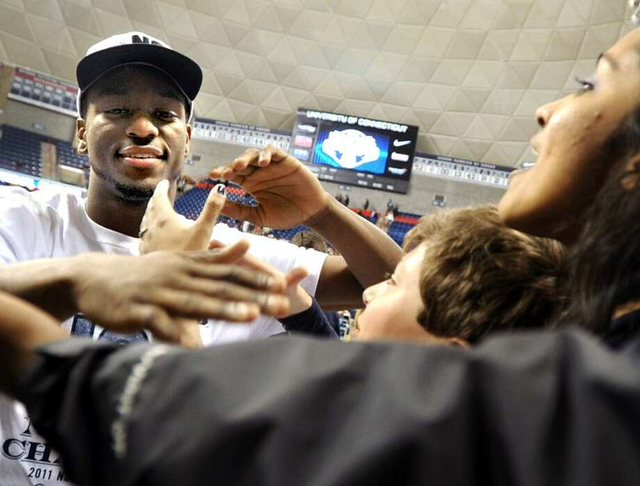 Storrs--Kemba Walker is greeted by Husky fans at Gampel Pavilion at last Tuesday's (04.05) pep rally.    Photo by Brad Horrigan/New Haven Register-04.05.11.