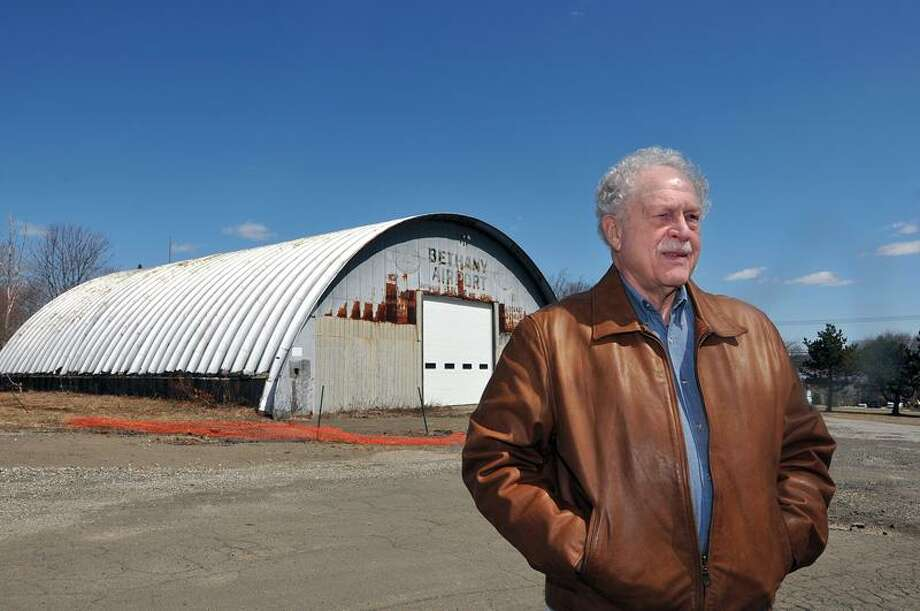 Bethany-- Art Slicer is hoping to rebuild the hanger at the Bethany Airport property with a newer, larger version of the building that will house a 4,000 square foot community center.  Photo by Peter Casolino/New Haven Register04/03/11 Cas110403