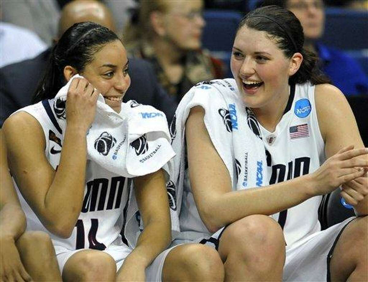 Connecticut's Bria Hartley, left, and Stefanie Dolson share a light moment late in the second half of an NCAA tournament second-round college basketball game against Kansas State in Bridgeport, Conn., Monday, March 19, 2012. Hartley was top scorer for UConn with 16 point. Connecticut won 72-26. (AP Photo/Jessica Hill)