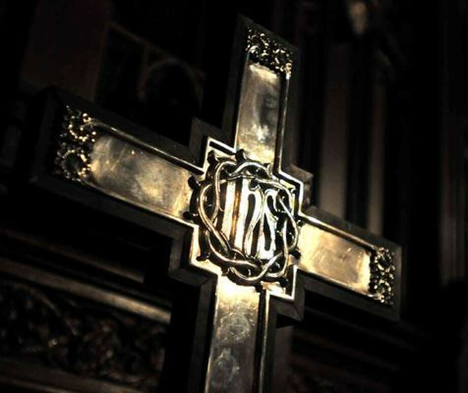 New Haven--This cross was among the stolen items returned to the Episcopal Church of St. Paul and St. James.  Photo by Brad Horrigan/New Haven Register-04.07.11.