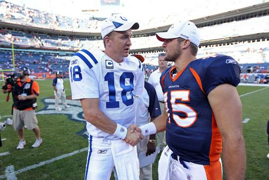Former Indianapolis Colts quarterback Peyton Manning, left, has signed a deal with the Denver Broncos. That may lead to incumbent Broncos QB Tim Tebow, right, playing somewhere else next season. (AP Photo/Greg Trott) Photo: AP / AP2010
