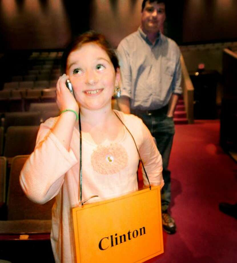Kitty Short of Clinton calls her grandfather after winning the New Haven Register Spelling Bee. Melanie Stengel/Register