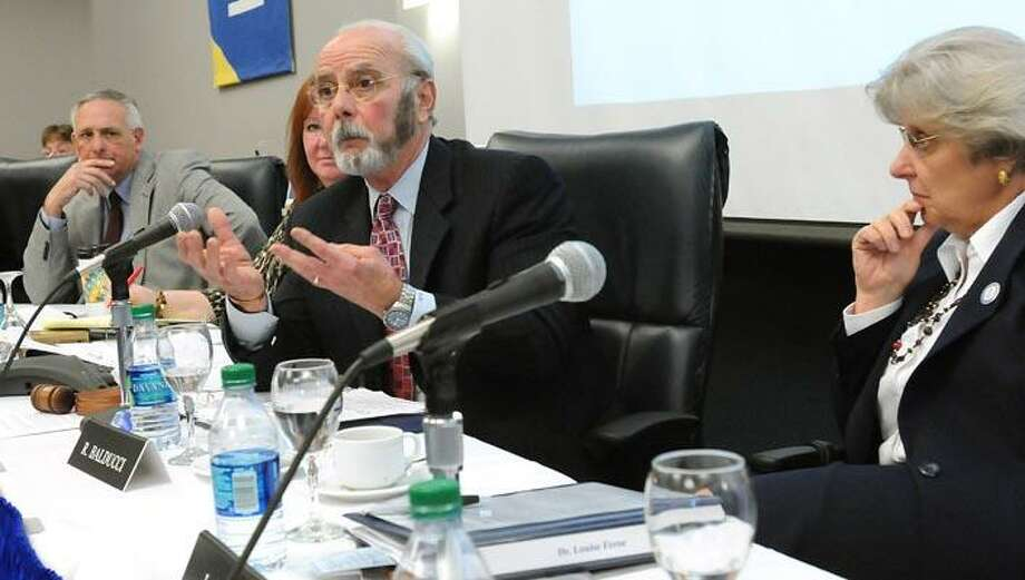 The CT State University Board of Trustess regular meeting was held at SCSU. Vice-chairman of the Board Richard Balducci second from right responds to criticisms by the SCSU faculty. Acting Chancellor Louise Feroe is at right. Photo by Mara Lavitt/New Haven Register4/7/11