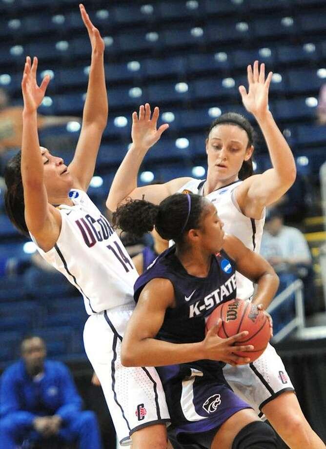 NCAA TOURNAMENT -UCONN/KANSAS STATE WOMENS' BASKETBALL 1st half Bria Hartley and Kelly Ferris squeeze Mariah White   Melanie Stengel/Register