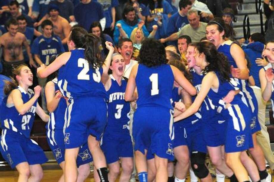 The Newtown girls basketball team celebrates its win over Hillhouse in the Class LL semifinals  Melanie Stengel/Register