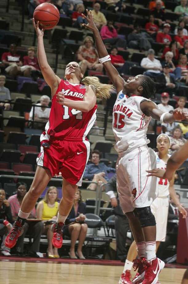 Marist's Casey Dulin (14) goes up for a layup against Georgia's Krista Donald in the second half of an NCAA tournament first-round women's college basketball game on Sunday, March 18, 2012, in Tallahassee, Fla. Marist beat Georgia 76-70. (AP Photo/Phil Sears) Photo: AP / AP