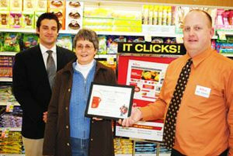 SUBMITTED PHOTO From left are Joshua Sheriff, a Salvation Army Field Representative, Midge Daviau, the local volunteer kettle coordinator, and Mark Sledziona, store manger at the Chittenango Tops Market.