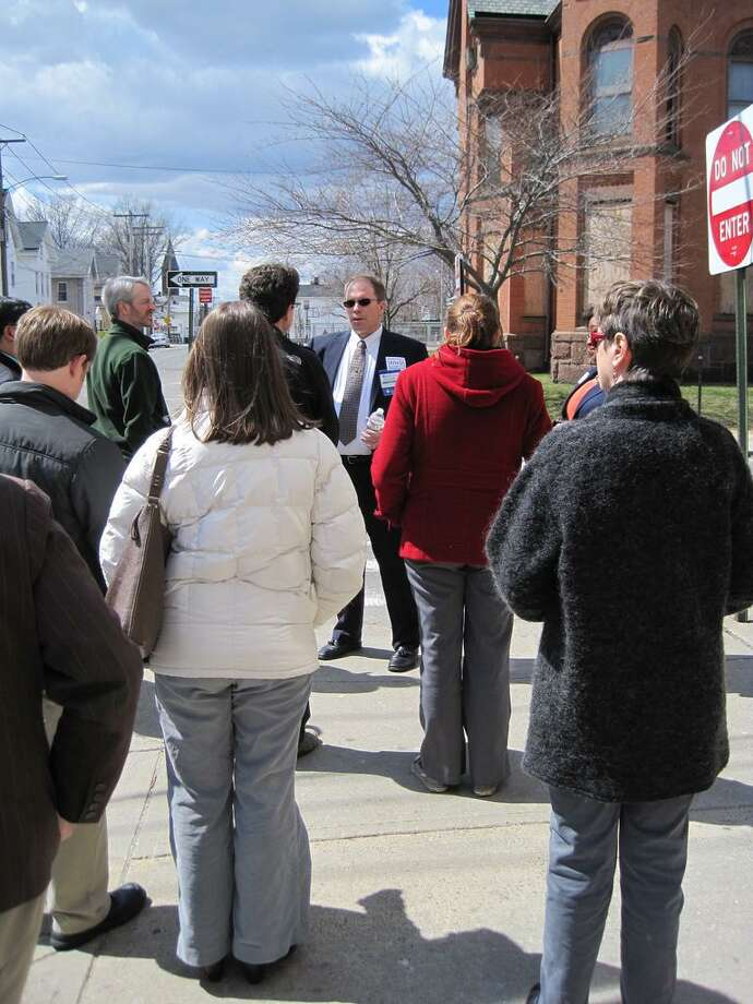 HealthCampCT@Yale organizer Matthew Browning walks with participants on a tour in New Haven between event sessions.  Contributed photo