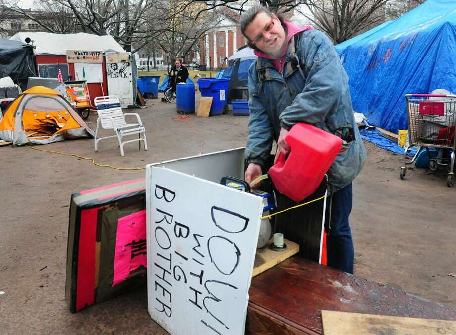 fillis a generator after it almost ran out of gas.  The recent nights have been cold and damp.  Occupy New Haven is the last group of size left occupying in New England.     Melanie Stengel/Register