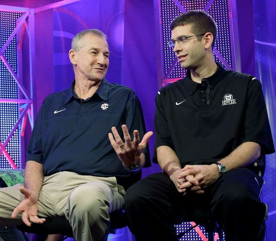 UConn coach Jim Calhoun, left, talks with Butler coach Brad Stevens prior to taping a TV interview for tonight's national title game. Associated Press.