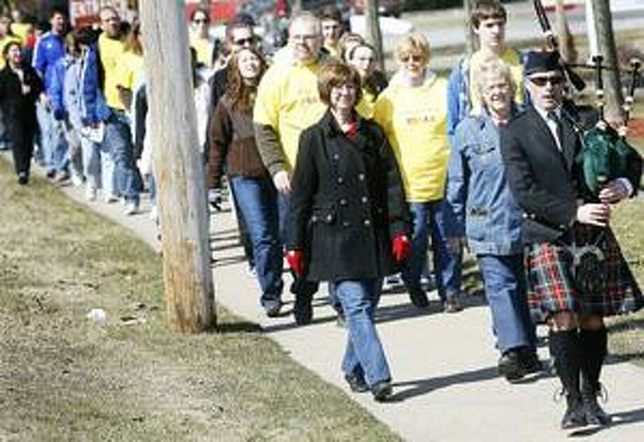 Photo by JOHN HAEGER Walkers take to the streets of Oneida for the annual Walk for Autism on Saturday, April 2, 2011.
