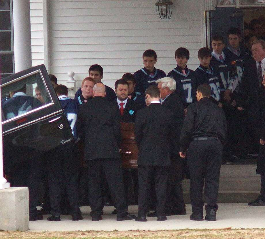 Oxford--Members of the Oxford High football team line the steps of the Cornerstone Assembly of God Church as the casket of their teammate, Brandon Giordano is carried inside. Giordano was killed in a crash Friday night. Photo- Peter Casolino/New Haven Register 03/16/12