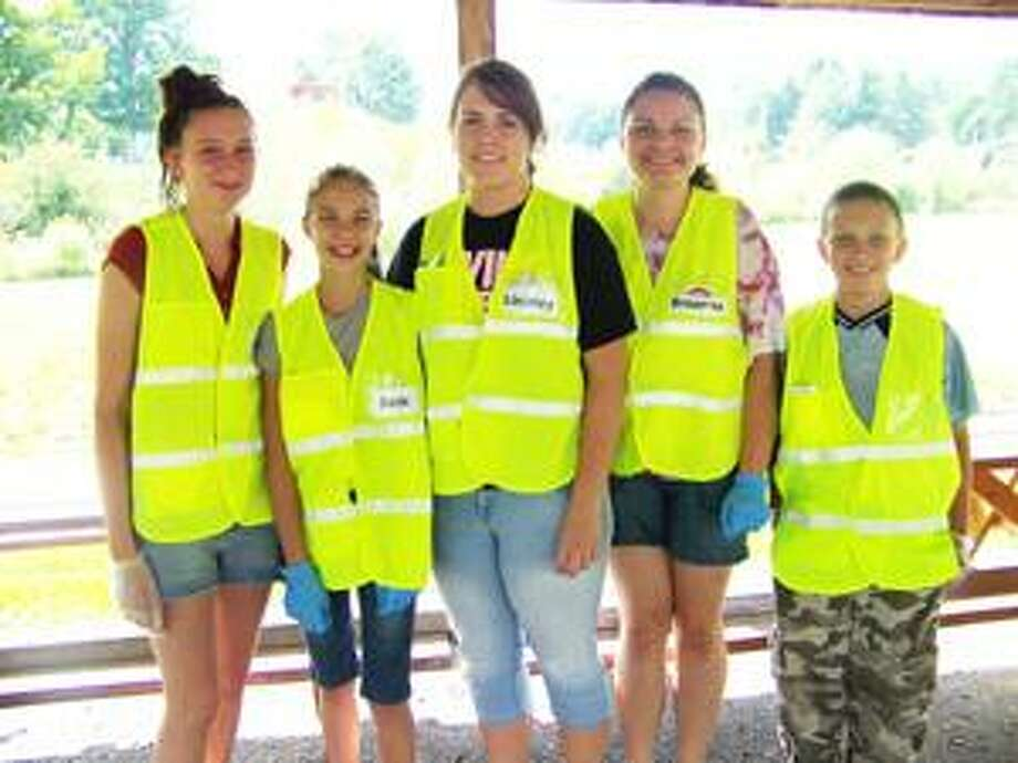 SUBMITTED PHOTO From left, BEST members Jackie Donlon, Samantha Whittaker, Lindsey Plows, Breanna Rogers, and Volunteer for the Day Michael Donlon during a trash pickup at Brookfield Town Park last August.