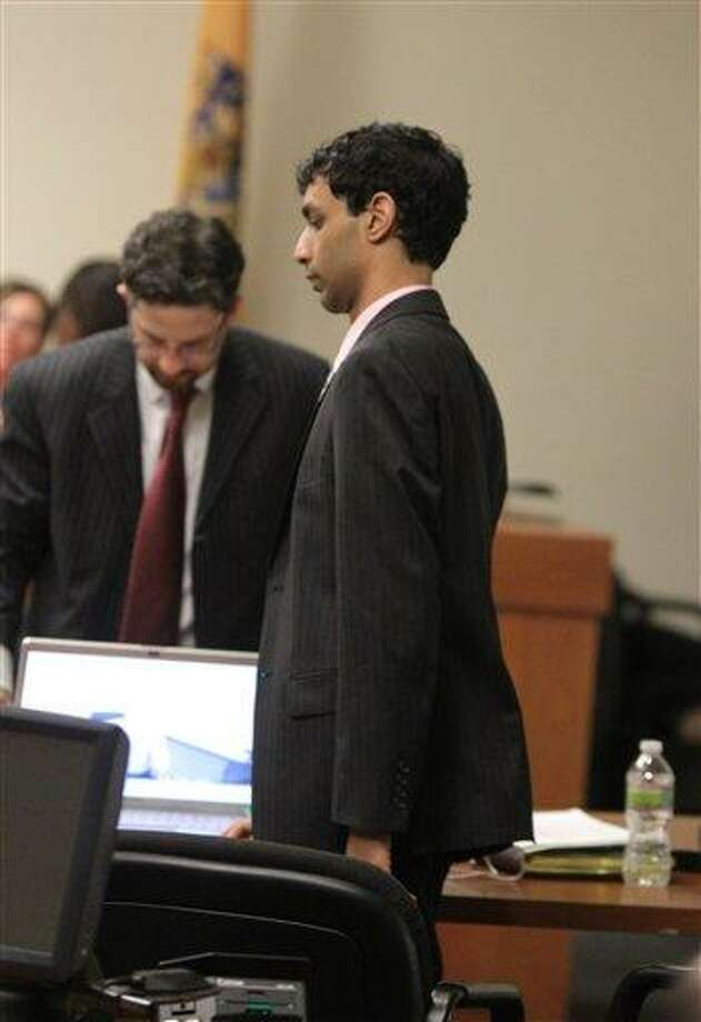 Defense attorney Philip Nettl, left, and former Rutgers student Dharun Ravi wait for the start of summations earlier this week at Ravi's trial at the Middlesex County Courthouse in New Brunswick, N.J.  Associated Press Photo: AP / Pool, The Star-Ledger