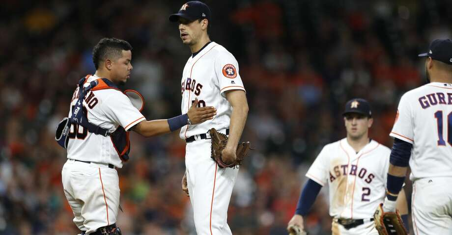 Houston Astros catcher Juan Centeno (30) pats starting pitcher Charlie Morton (50) as manager A.J. Hinch walks out to pull him during the seventh inning of an MLB game at Minute Maid Park, Wednesday, Aug. 16, 2017, in Houston.  ( Karen Warren / Houston Chronicle ) Photo: Karen Warren/Houston Chronicle