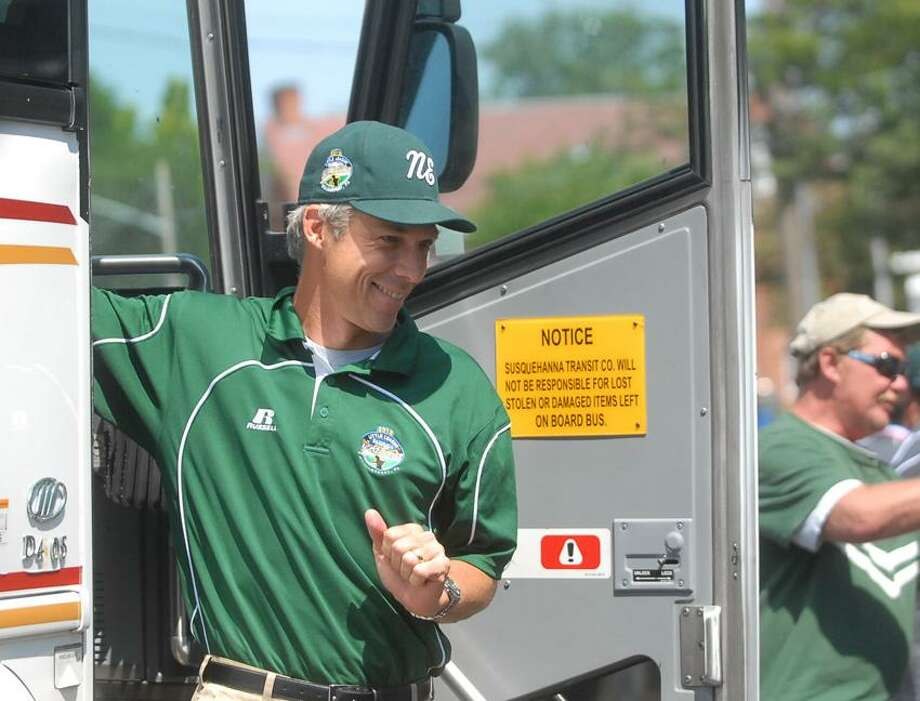 Fairfield's Bill Meury smiles as he gets off the bus Thursday afternoon. Fairfield American Little Leagues fans welcome home the baseball team from the Little League World Series in Williamsport, pa. Fairfield finished as one of the top four United States team in the country. Mary Albl/New Haven Register