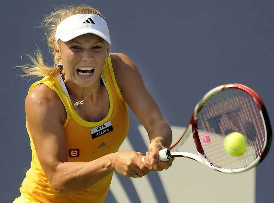 Caroline Wozniacki returns a shot to Sofia Arvidsson in their singles  match at the New Haven Open in New Haven, Conn., Wednesday, Aug. 22, 2012.  (Bob Child Photo) Photo: New Haven Register / Bob Child