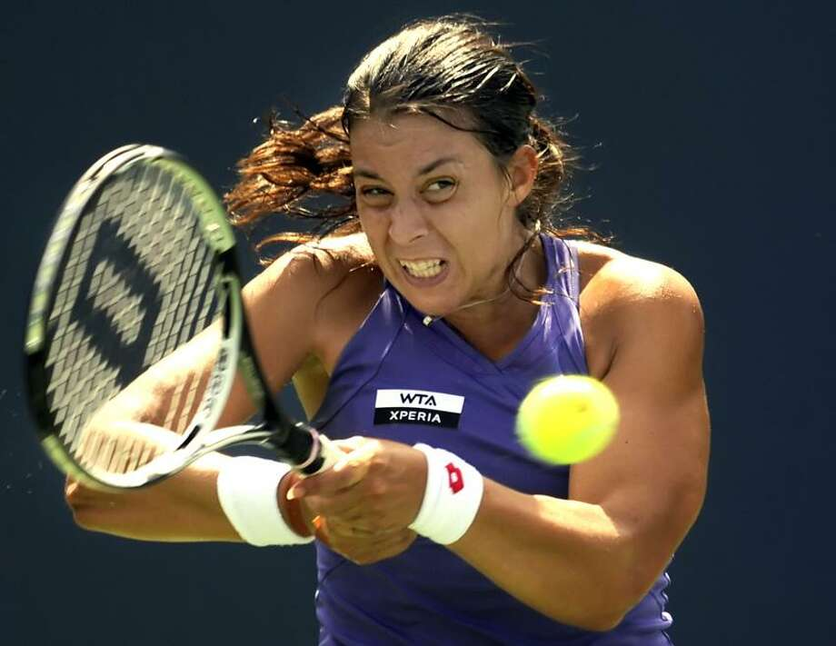 Marion Bartoli of France returns a shot to Sloane Stephens of the U.S. in their second round singles  match at the New Haven Open in New Haven, Conn., Tuesday, Aug. 21, 2012.  (Bob Child Photo) Photo: New Haven Register / Bob Child