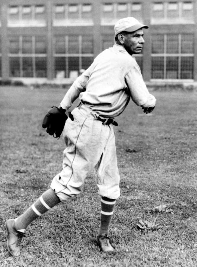 "Charles ""Chief"" Bender is shown pitching in a Wentz-Olney team uniform, a Philadelphia semi-pro club, in Aug. 1930.  (AP Photo) Photo: ASSOCIATED PRESS / AP1930"