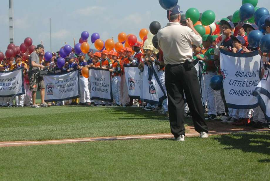 Photo by Mary Albl/Register Teams line up during last week's opening ceremony at the Little League World Series.