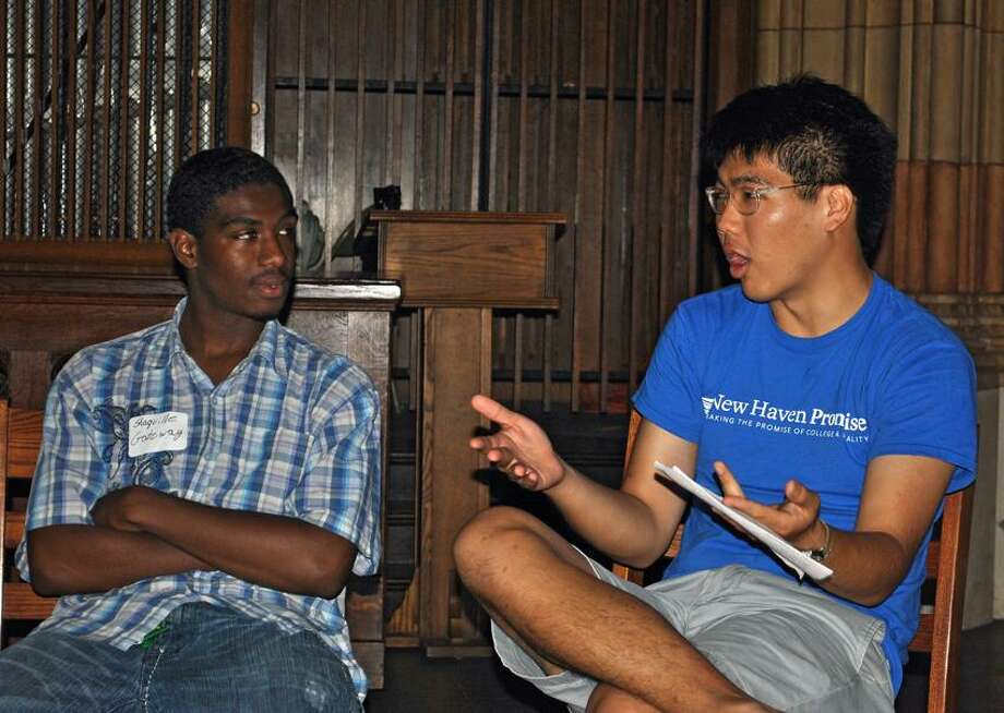 Shaquille Glasper, left, a Gateway student Promise scholar of 2011, listens as Carl Chen, a Yale student fellow who helped plan the Promise scholarship program, shares his experiences in college with other Promise scholar students. Photo by Jen Fengler/for the Register