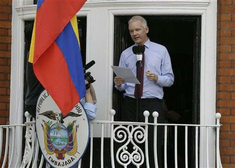 "Julian Assange, founder of WikiLeaks, makes a statement Sunday from a balcony of the Equador Embassy in London. Assange called on United States President Barack Obama to end a ""witch hunt"" against the secret-spilling WikiLeaks organization. Associated Press Photo: AP / AP"