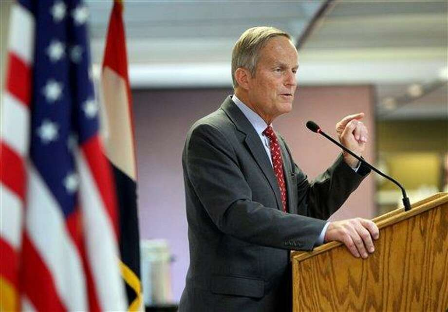 FILE  - This Aug. 10, 2012 file photo shows Todd Akin, Republican, candidate for U.S. Senator from Missouri, speaks at the Missouri Farm Bureau candidate interview and endorsement meeting in Jefferson City, Mo. Akin, Missouri's GOP Senate candidate, has questioned whether women can become pregnant when they're raped, Sunday, Aug. 19, 2012. (AP Photo/St. Louis Pos-Dispatch, Christian Gooden) Photo: AP / St. Louis Post-Dispatch