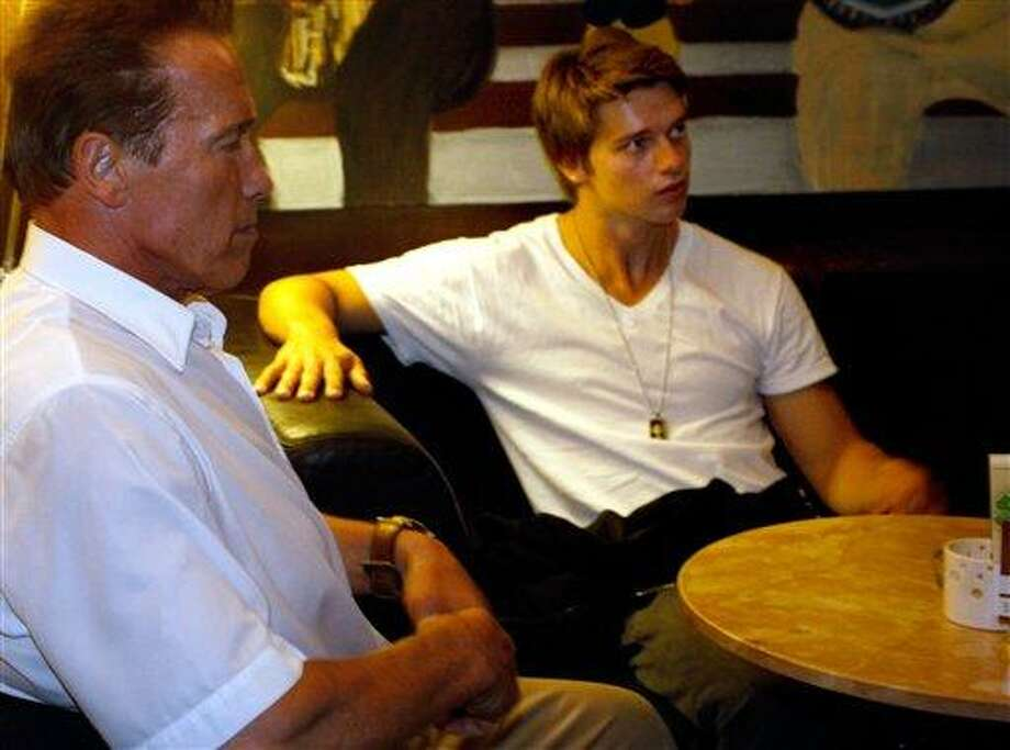 "This file photo, shows Austrian-born actor and former Californian governor Arnold Schwarzenegger , left, and his son Patrick, right, sitting in a coffee bar in Graz, Austria. Partick Schwarzenegger, now 18, said Saturday, March 10, 2012, that he has been treated for injuries after getting in ""a little ski accident"" in Idaho. Photo: AP / AP2011"