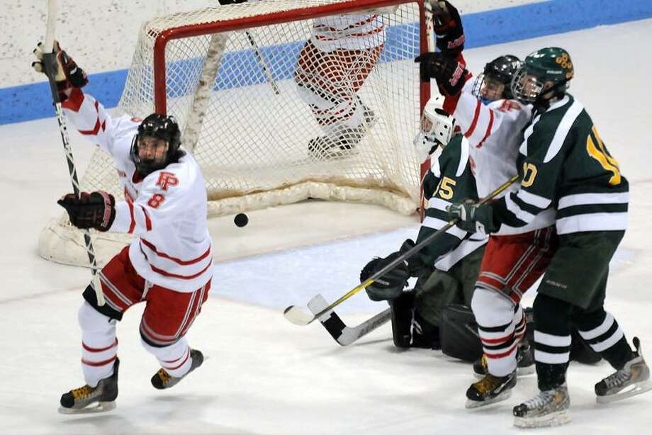 Ingalls Rink, Yale Univ. CIAC boys hockey quarterfinals between Hamden and Fairfield Prep. Prep won 2-0. 1st period left to right, first goal by Prep's #8 David White with Hamden goalie Andrew Varga, Prep's A.J. Unker, and Hamden's Connor Walsh. Photo by Mara Lavitt/New Haven Register3/10/12