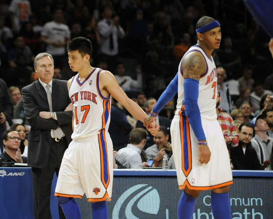 There was a time when the Knicks' Jeremy Lin (17) was the hottest thing in the NBA and the scourge of loose-lipped broadcasters across the country. But, as Register columnist Chip Malafronte points out, ever since Carmelo Anthony, right, rejoined the mix, the two have displaced Felix and Oscar as New York's resident Odd Couple, and, with the Knicks in the midst of a four-game losing streak, coach Mike D'Antoni, left, is looking more and more like the odd man out at the end of the year. (AP photo) Photo: AP / AP2012
