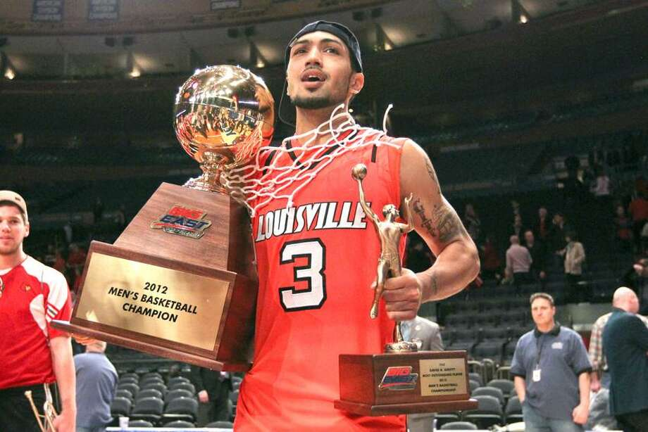 Mar 10, 2012; New York, NY, USA;  Louisville Cardinals guard Peyton Siva (3) celebrates winning the championship game against the Cincinnati Bearcats at the Big East Tournament held at Madison Square Garden.  Mandatory Credit: Anthony Gruppuso-US PRESSWIRE Photo: US PRESSWIRE / Anthony Gruppuso