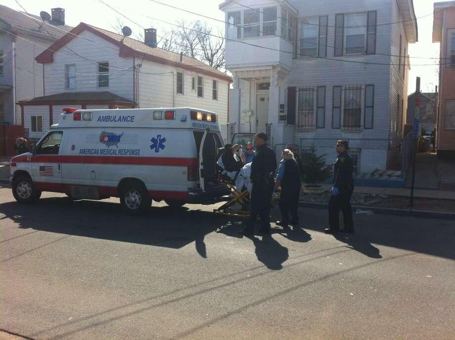 Loading suspect into ambulance