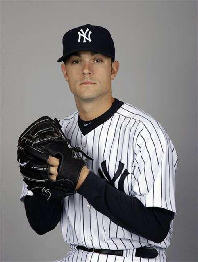 FILE - This Feb. 27, 2012 file photo shows New York Yankees baseball player David Robertson. The Yankees took their first misstep of 2012 when All-Star setup man David Robertson sprained his right foot when he fell down stairs while moving boxes in his spring training home. An initial X-ray was negative, and the reliever was taken a hospital for an MRI Thursday, March 8, 2012. (AP Photo/Matt Slocum, File) Photo: ASSOCIATED PRESS / AP2012