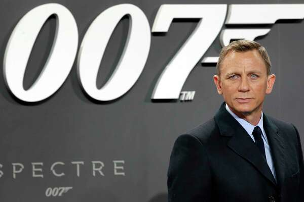 """FILE - In this Oct. 28, 2015, file photo, actor Daniel Craig poses for the media as he arrives for the German premiere of the James Bond movie 'Spectre' in Berlin, Germany. Craig announced on """"The Late Show with Stephen Colbert"""" Aug. 15, 2017, that he would return as the British super spy in 2019's """"Bond 25."""" (AP Photo/Michael Sohn, File) ORG XMIT: PAPM101"""