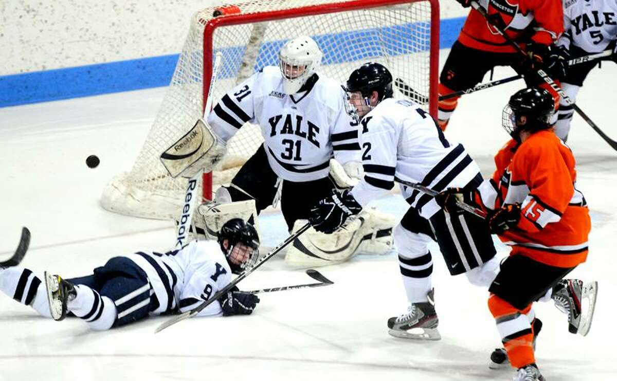 Left to right, Brian O'Neill, goalie Nick Maricic and Gus Young defend against Princeton in the second period on 3/3/2012.Photo by Arnold Gold/New Haven Register AG0441E