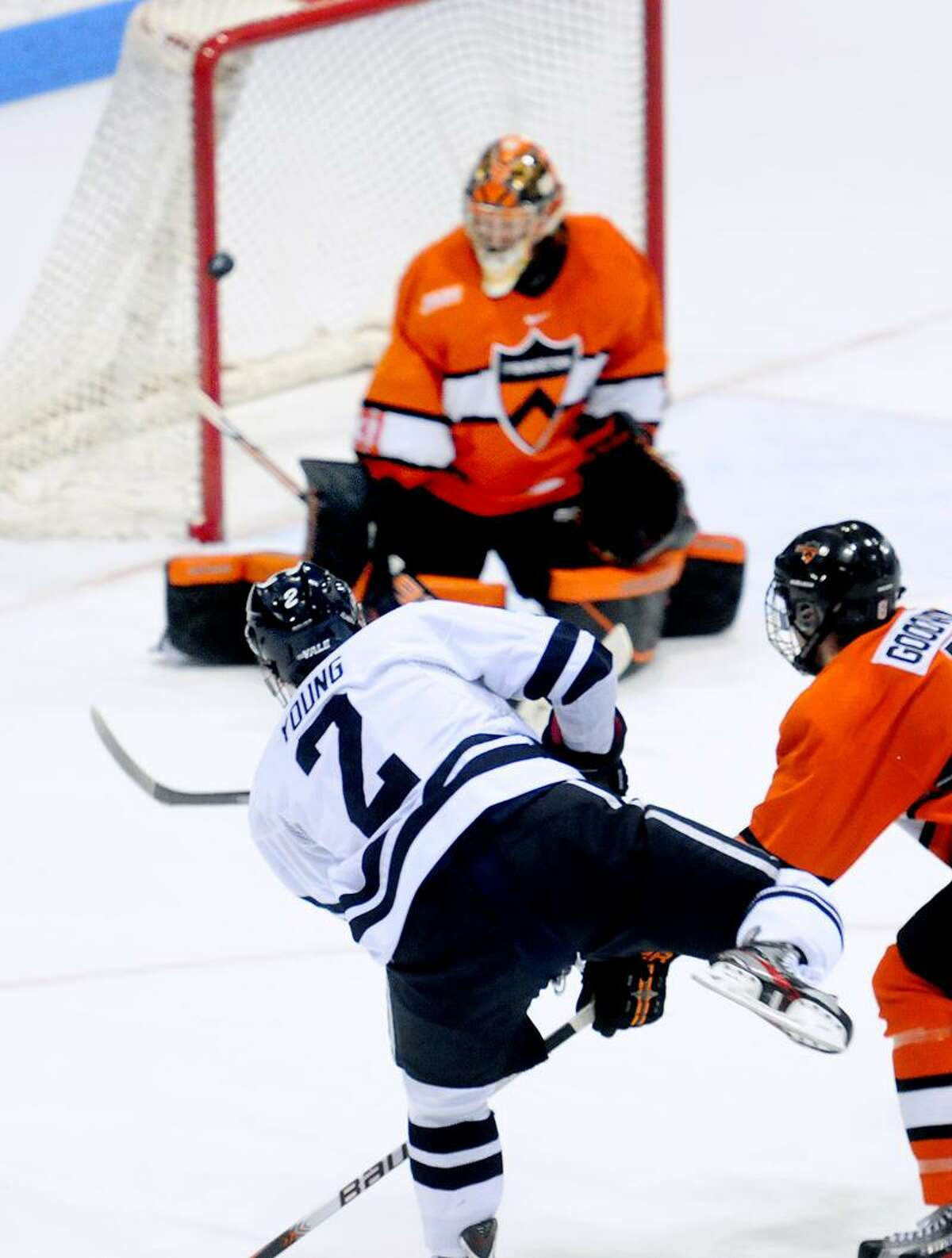 Gus Young (bottom left) of Yale hits a shot into the post against Princeton in the first period on 3/3/2012.Photo by Arnold Gold/New Haven Register AG0441E