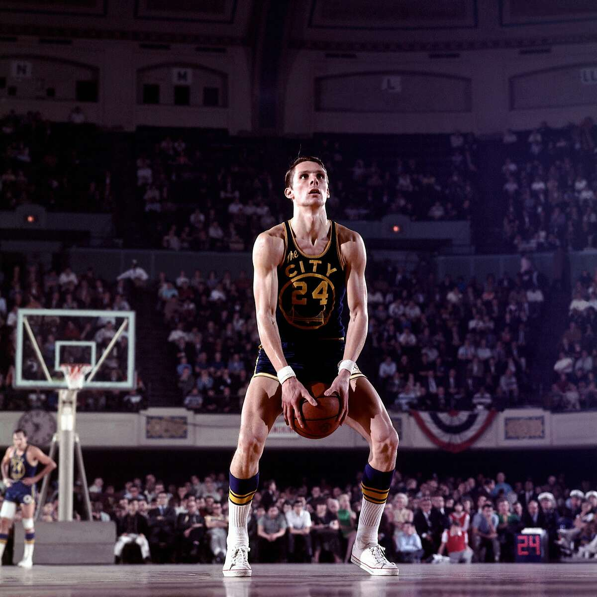 Rick Barry of the Golden State Warriors shoots with his unorthodox free throw style during a game in the 1970s.