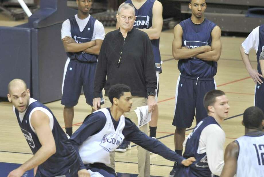Connecticut head coach Jim Calhoun, center, watches players during his first practice since having successful lower back surgery in Storrs, Conn., Friday, March 2, 2012.  (AP Photo/Jessica Hill) Photo: AP / AP2012