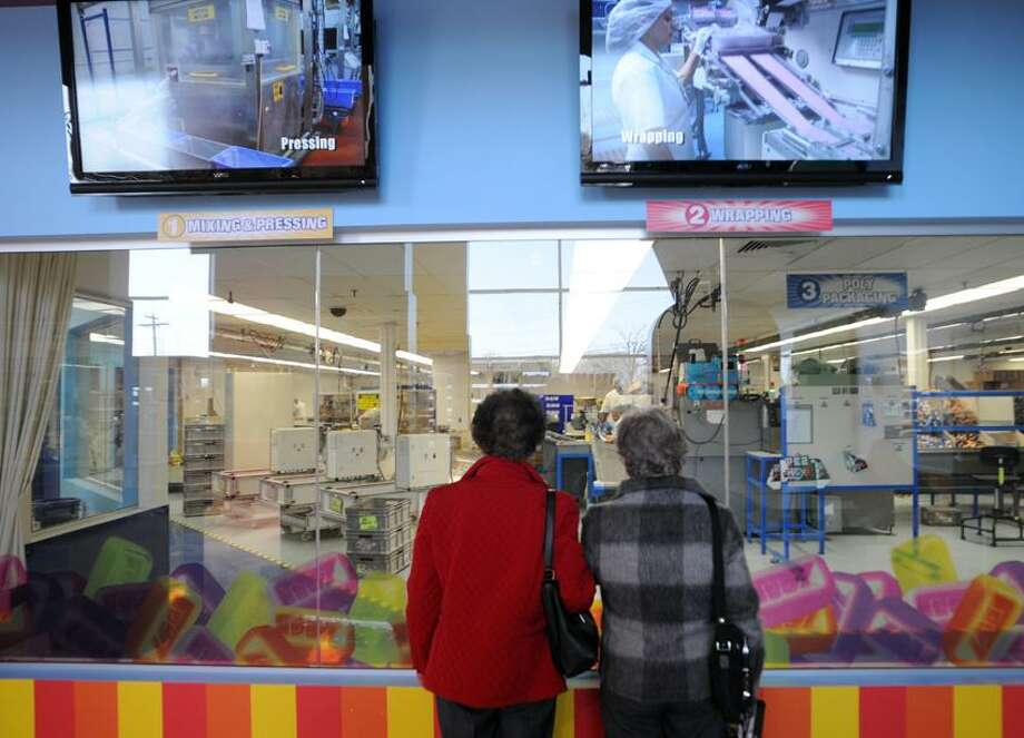 Shirly Schultz, left, and Jane Foster, right, both of Portland, Conn., look at a part of the PEZ candy factory as they tour the PEZ Visitors Center in Orange. (Peter Hvizdak/Register) Photo: New Haven Register / ©Peter Hvizdak /  New Haven Register