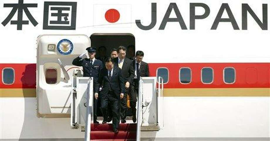 Japanese Prime Minister Yoshihiko Noda, center, arrives at Andrews Air Force Base, Md., Sunday. President Barack Obama is scheduled to meet with Noda at the White House, Monday. Associated Press Photo: AP / FR170079 AP