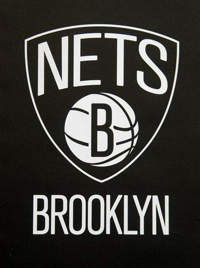 One of the new Brooklyn Nets logos is displayed during a news conference in the Brooklyn borough of New York, Monday, April 30, 2012. The Nets will be moving from New Jersey to the new Barclays Center in Brooklyn for the 2012-2013 NBA basketball season. (AP Photo/Seth Wenig) Photo: ASSOCIATED PRESS / AP2012