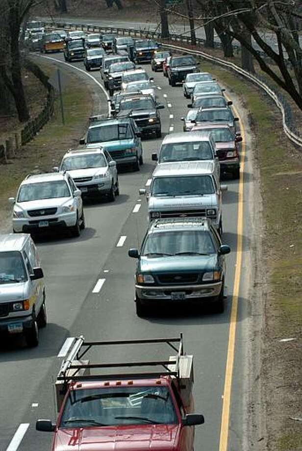 The Merritt Parkway may be one of the four most scenic routes in New England, but that doesn't mean Register sports columnist Chip Malafronte likes to sit in traffic on it. (AP Photo/Douglas Healey) Photo: ASSOCIATED PRESS / AP2004