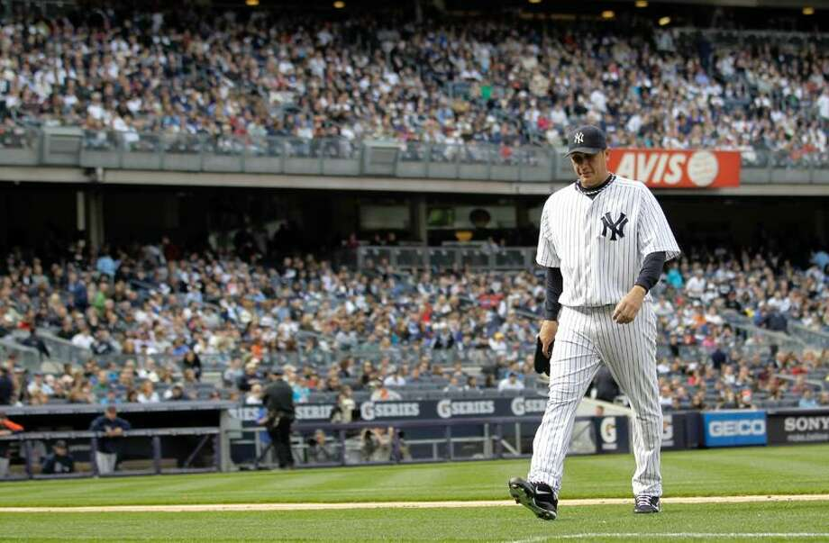 New York Yankees starting pitcher Freddy Garcia is pulled from a baseball game during the second inning against the Detroit Tigers, Saturday, April 28, 2012, in New York. (AP Photo/Julio Cortez) Photo: AP / AP2012