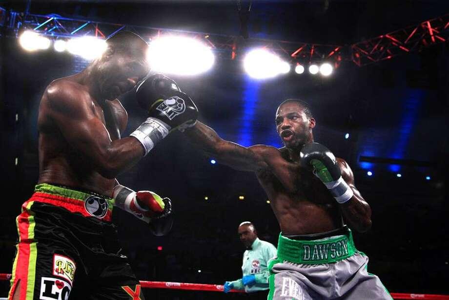 Chad Dawson throws a right at Bernard Hopkins in the third ound of their  light heavyweight boxing match in Atlantic City, N.J., Saturday, April 28, 2012. Dawson won a majority decision. (AP Photo/Mel Evans) Photo: AP / AP