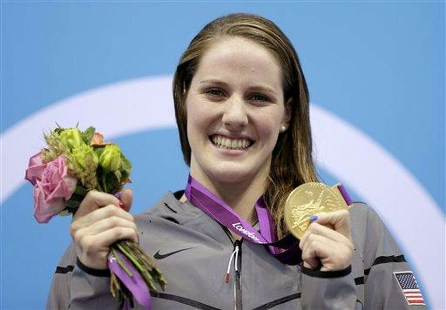 Missy Franklin holds her gold medal in the women's 200-meter backstroke final at the Aquatics Center during the 2012 Summer Olympics in London Fridayj (Associated Press) Photo: AP / AP