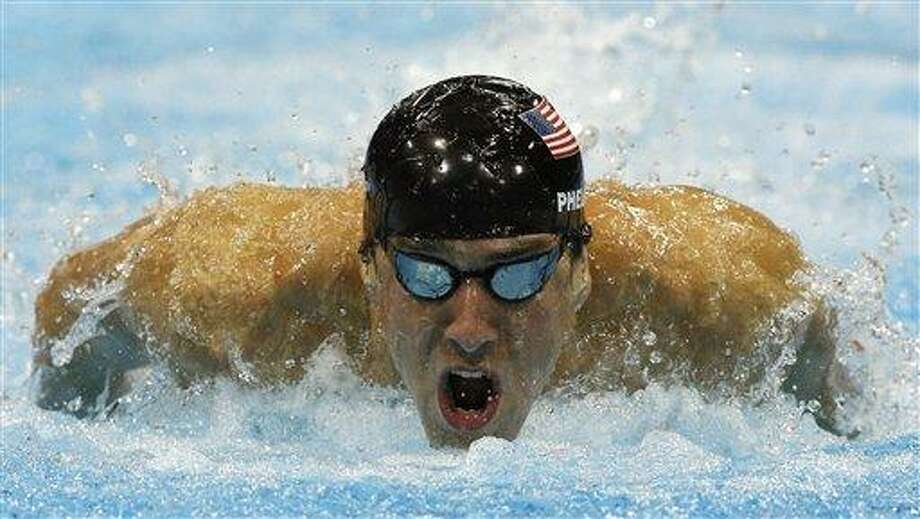United States' Michael Phelps competes in a men's 100-meter butterfly swimming semifinal at the Aquatics Centre in the Olympic Park during the 2012 Summer Olympics in London, Thursday, Aug. 2, 2012. (AP Photo/Michael Sohn) Photo: AP / AP
