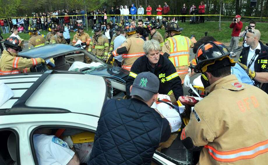 "Seymour High School: Seymour and Oxford Emergency Services as well as CT State Police and agency partners staged a mock prom-night crash with Seymour High School seniors as the ""victims"" for the benefit of Seymour and Oxford juniors who watch as the emergency services show how they deal with a multiple-vehicle crash with fatalities.  Mara Lavitt/New Haven Register4/28/12"